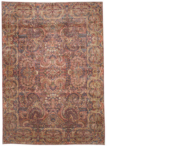 A Lavar Kerman carpet South Central Persia size approximately 9ft. 7in. x 13ft. 6in.