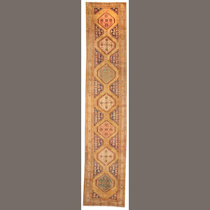 A Serab runner Northwest Persia size approximately 3ft. 6in. x 17ft. 4in.