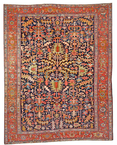 A Heriz carpet Northwest Persia size approximately 9ft. 5in. x 11ft. 10in.