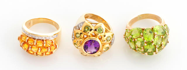 A collection of three peridot, topaz, amethyst, diamond, 14k and 18k gold rings