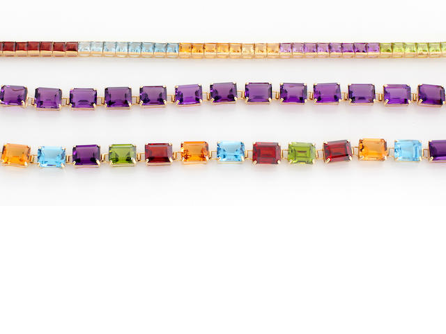 A collection of three gem-set and 14k gold bracelets