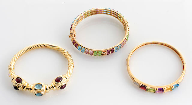A collection of three gem-set, glass bead, diamond and 14k gold bangle bracelets