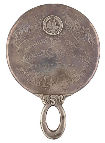 A sterling silver yachting trophy for the Larchmont Yacht Club  circa 1899 8 x 5-1/2 in. (20.3 x 14 cm.) length x diameter.