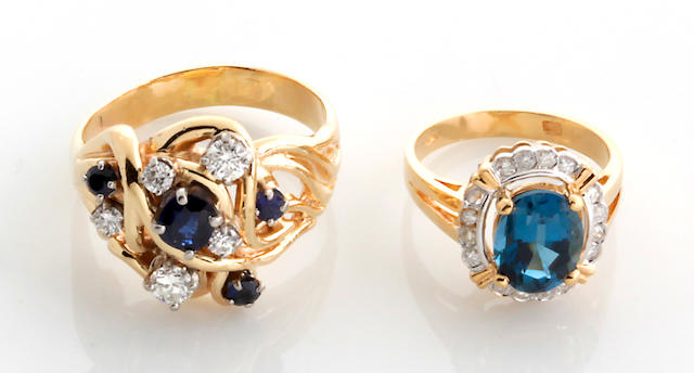 A collection of two diamond, sapphire, blue topaz and 14k gold rings