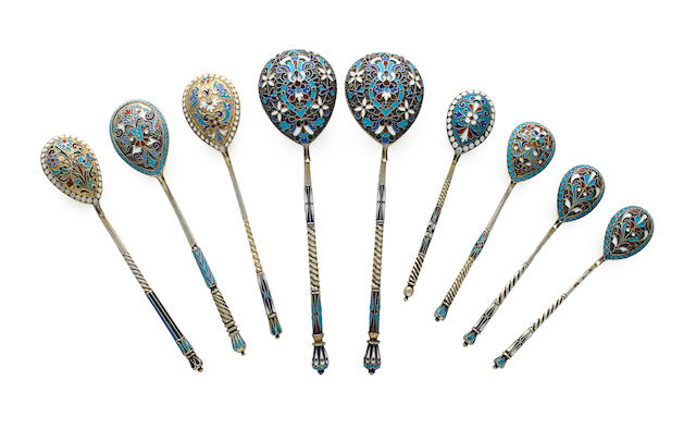 Nine Russian 84 standard silver and parcel enameled spoons Moscow, the two large spoons  1908-1917, mark of Nikolai Zverev, the other spoons late 19th century, various makers