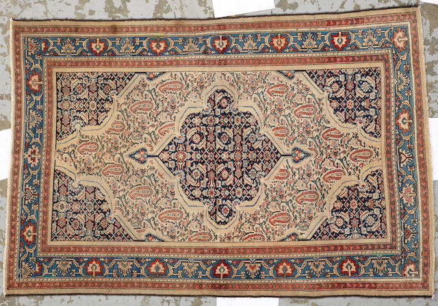 A Malayer rug Central Persia size approximately 4ft. 2in. x 6ft. 3in.