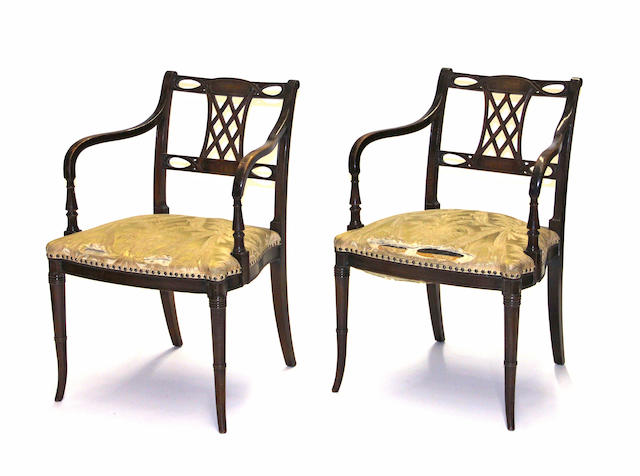 A pair of Regency style mahogany armchairs