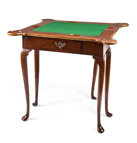 A George II walnut fold top games table <BR /> second quarter 18th century