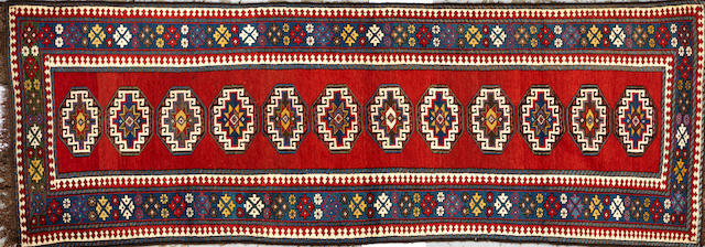 A Karabagh long carpet Caucasus size approximately 3ft. 6in. x 9ft. 11in.