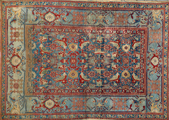 An Agra rug India size approximately 4ft. 5in. x 6ft. 2in.
