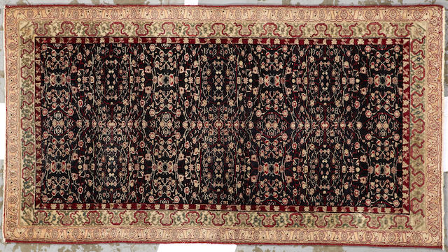 An Agra rug India size approximately 3ft. x 5ft. 6in.