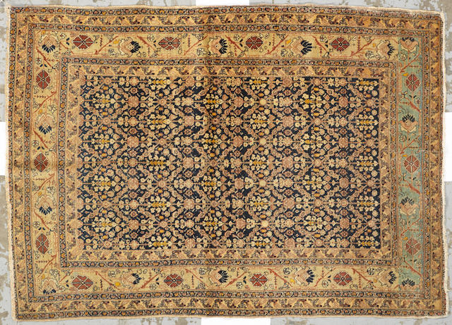 A Tabriz rug Northwest Persia size approximately 4ft. 2in. x 5ft. 9in.