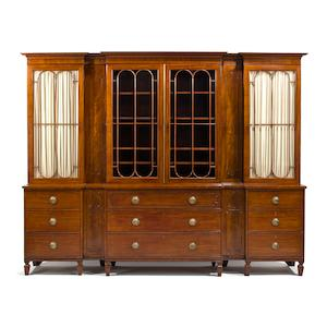 A Regency parcel ebonized mahogany breakfront bookcase