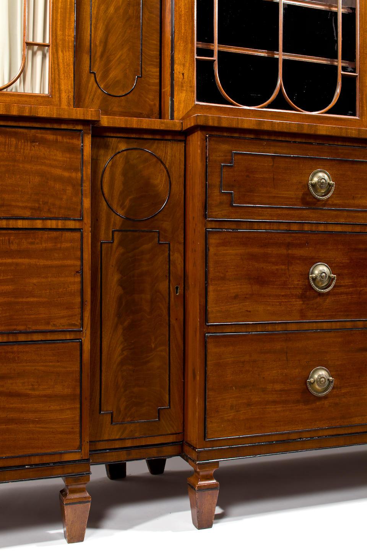 A Regency parcel ebonized mahogany breakfront bookcase