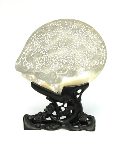 A reticulated  mother-of-pearl shell on a wood stand Late Qing/Republic Period