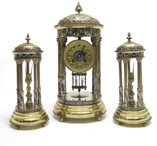 A French champlevé and gilt bronze three piece portico clock garniture late 19th/early 20th century