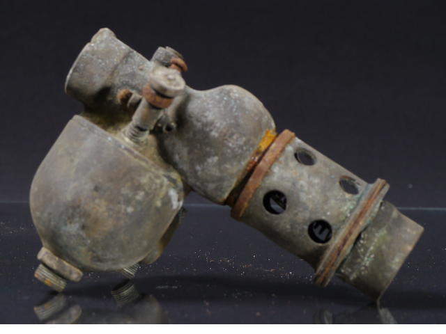 A bronze Schebler carburetor, unknown model,