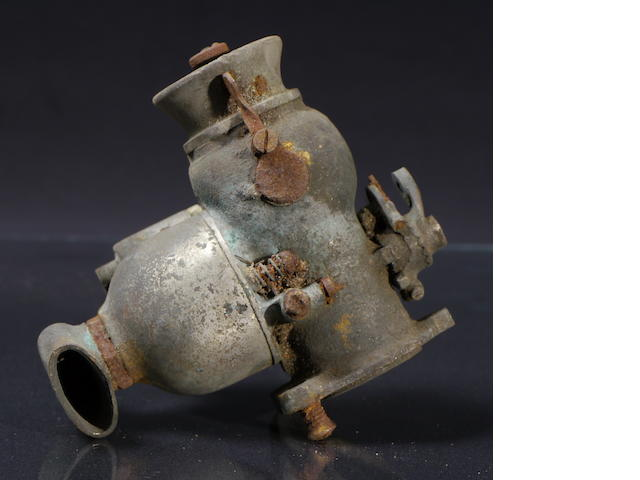 A large sized nickel-plated bronze Schebler carburetor,