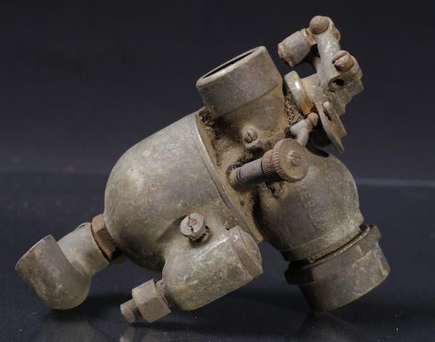 A nickel-plated bronze Schebler carburetor,