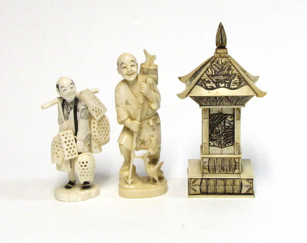 A pair of Japanese tinted and carved ivory figures