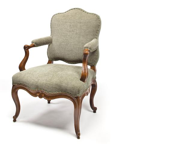 A pair of provincial Louis XV carved beechwood fauteuils<BR />mid-18th century