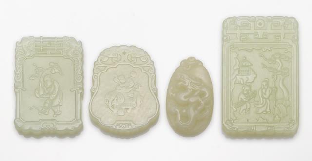 Four white jade pendants/plaques