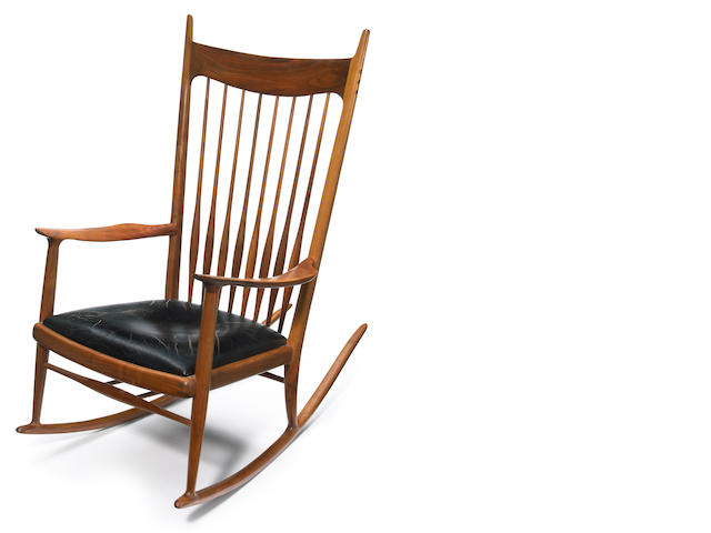A Sam Maloof spindle-back rocking chair with leather seat <BR /> circa 1966