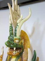 A sancai glazed pottery model of a zhenmu shou with leonine head Tang dynasty