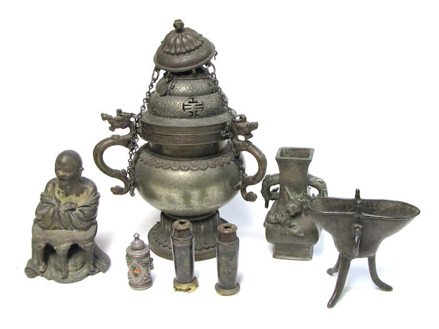 A group of Asian metal decorations