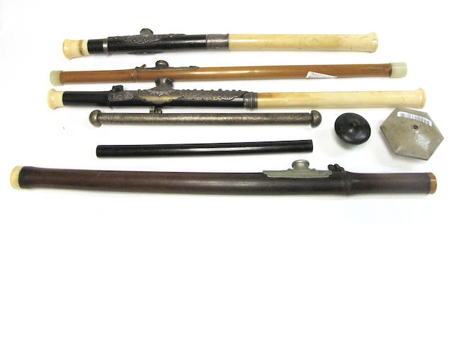 A group of four opium pipes