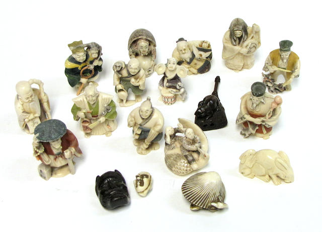 A group of fifteen Japanese tinted ivory miniature human and animal figures 20th century