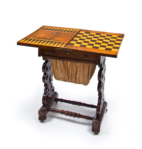 A Victorian parcel ebonized walnut parquetry fold top games table