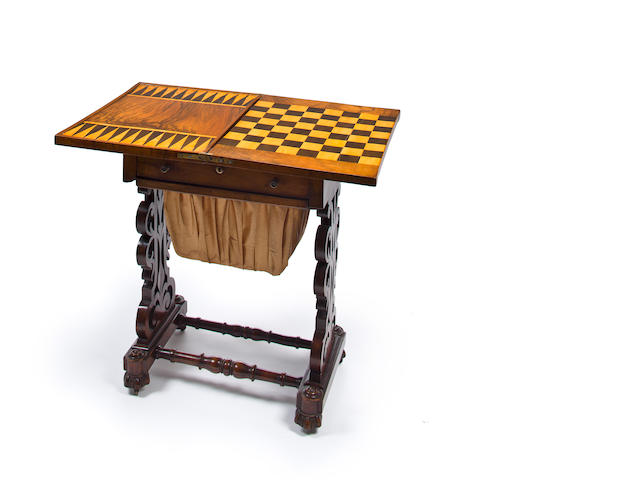 A Victorian partially ebonized walnut parquetry folding top games table
