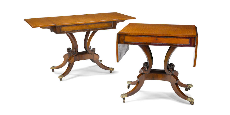 A fine pair of Regency inlaid figured mahogany sofa tables first quarter 19th century