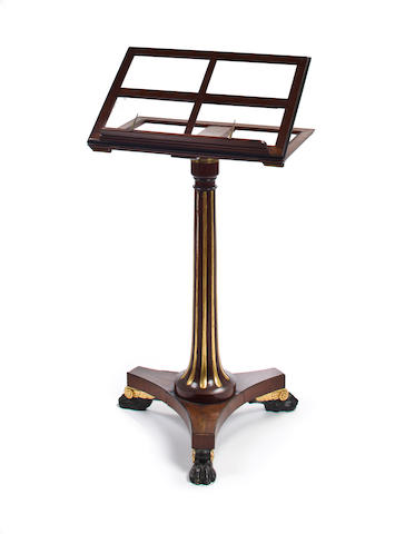 A late Regency mahogany and parcel gilt reading stand