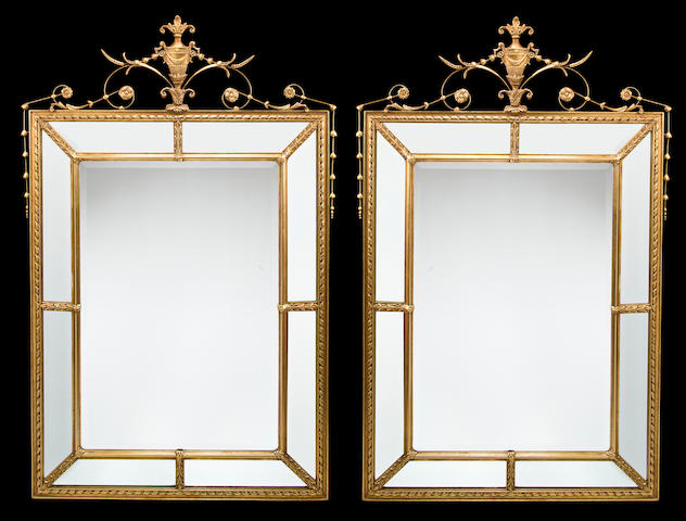 A pair of George III style carved giltwood and gilt composition mirrors<BR />mid-20th century