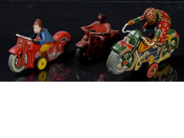 A selection of three motorcycle toys,
