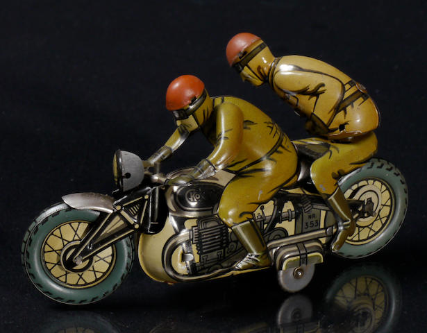 A German wind-up motorcycle tin toy,