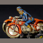 A tin double motorcycle wind-up toy,
