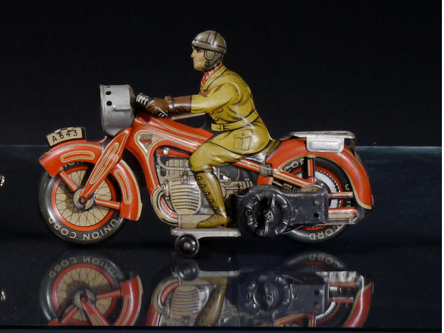 An Arnold wind-up tin motorycle lithographic toy,