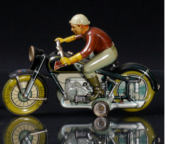 "An Arnold ""Mac 700"" tin, wind-up motorcycle lithographic toy,"