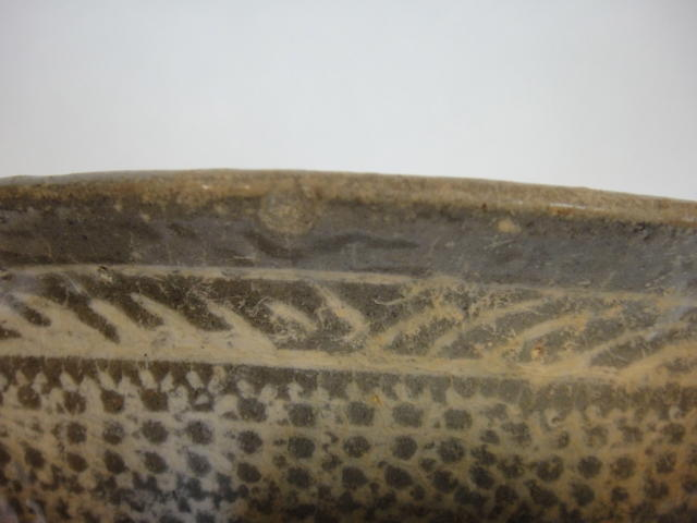 A buncheong ware bowl with impressed slip decoration Joseon Dynasty, 15th century