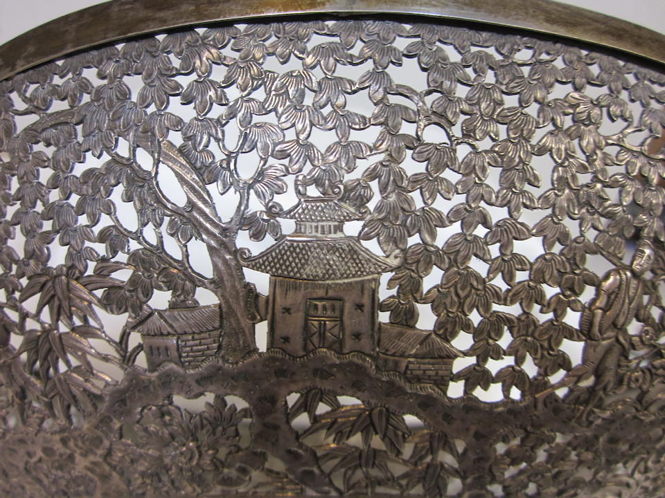 An elaborately chased and pierced silver bowl Late 19th century