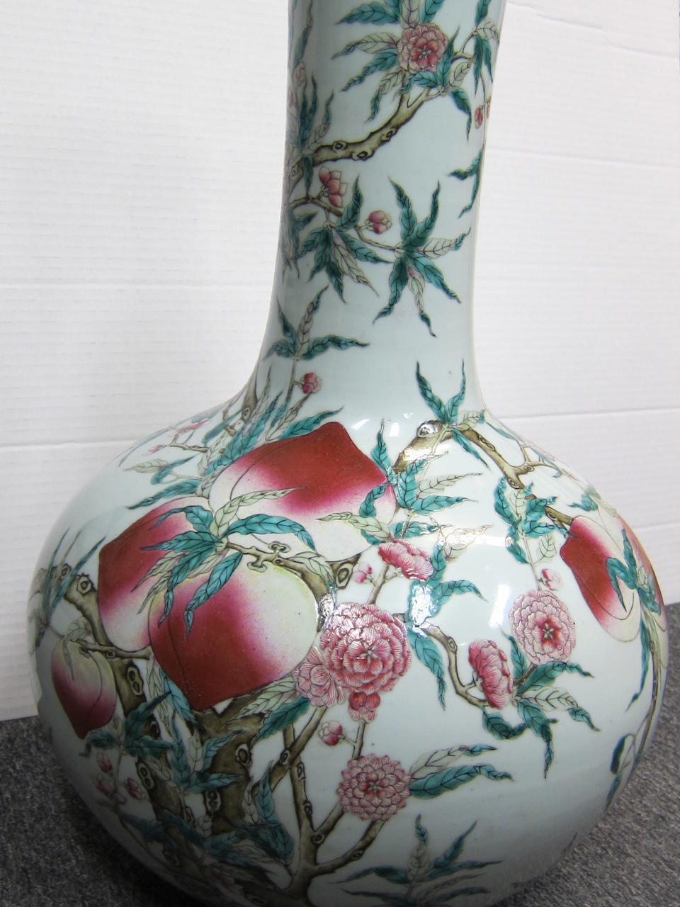 A pair of large famille rose enameled porcelain stick neck vases Late Qing dynasty/Republic period