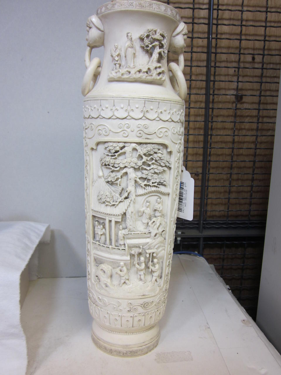 A large carved and pieced ivory and covered vase 19th/20th century