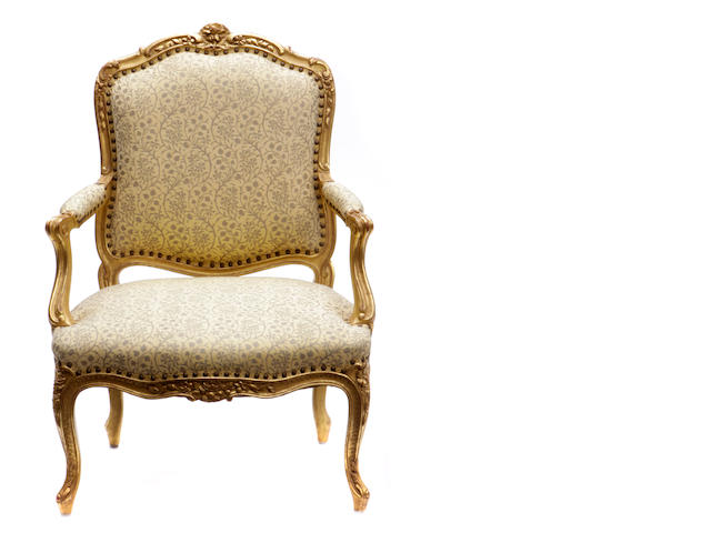 A Louis XV style giltwood fauteuil and side chair