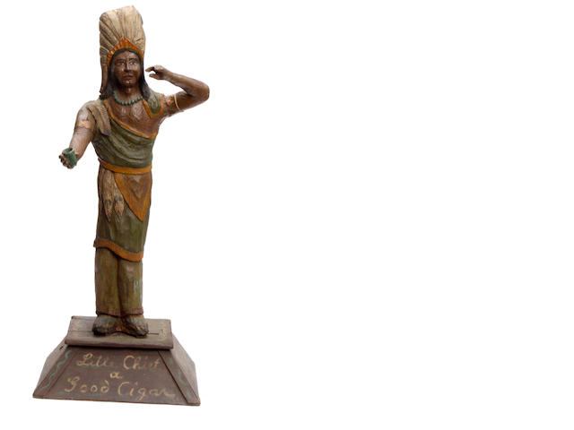 A paint decorated and carved wood cigar store Indian