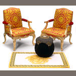 A pair of Gianni Versace carved giltwood, painted and upholstered open armchairs  in the Louis XV taste