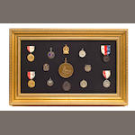 A collection of 13 yachting medals in a common frame<BR /> early 20th century 2-3/4 in. (6.9 cm.) the largest; 14-1/4 x 22-1/4 in. (36.1 x 56.5 cm.) framed.