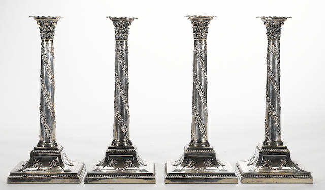 A plated set of four garland draped Corinthian columnar candlesticks Ellis-Barker Silver Companies, Birmingham